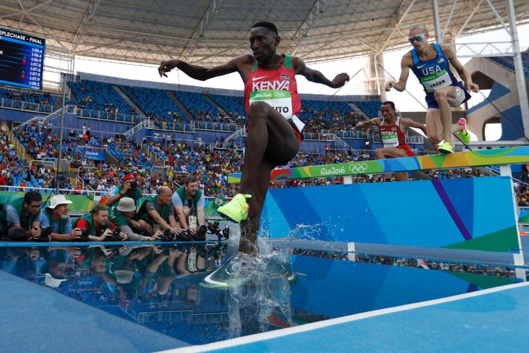 Kenya's Conseslus Kipruto competes in the Men's 3000m Steeplechase Final during the athletics event at the Rio 2016 Olympic Games at the Olympic Stadium in Rio de Janeiro on August 17, 2016. (ADRIAN DENNIS/AFP/Getty Images)