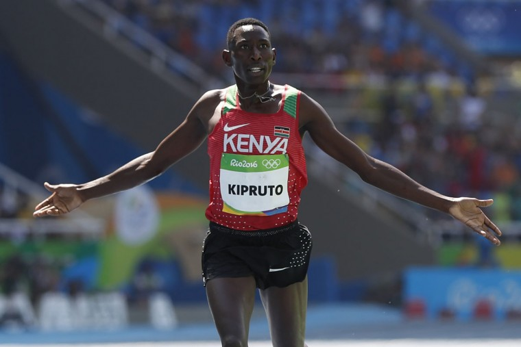 Kenya's Conseslus Kipruto celebrates after winning the Men's 3000m Steeplechase Final during the athletics event at the Rio 2016 Olympic Games at the Olympic Stadium in Rio de Janeiro on August 17, 2016. (ADRIAN DENNIS/AFP/Getty Images)