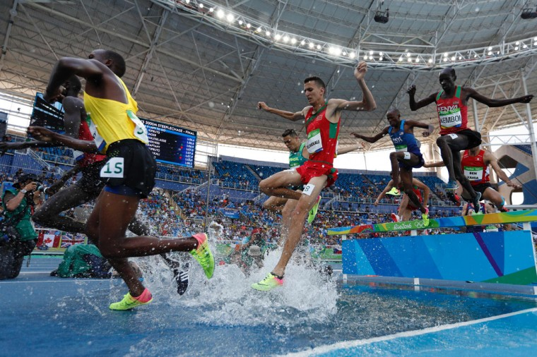 Athletes compete in the Men's 3000m Steeplechase Final during the athletics event at the Rio 2016 Olympic Games at the Olympic Stadium in Rio de Janeiro on August 17, 2016. (ADRIAN DENNIS/AFP/Getty Images)