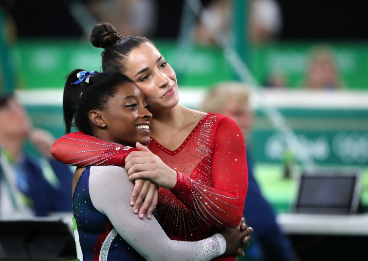 U.S. gymnasts Simone Biles, left, and Aexandra Raisman celebrate after winning the gold and silver medals, respectively, in the women's All-Around Individual at the Summer Olympics in Rio de Janeiro, Brazil, on Thursday, Aug. 11, 2016. (Brian Peterson/Minneapolis Star Tribune/TNS)