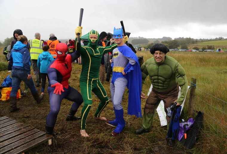 Competitors dressed as super-heroes pose for a photograph before they swim the course at the World Bog Snorkelling Championships in Waen Rhydd peat bog at Llanwrtyd Wells, south Wales on August 28, 2016. Entrants must negotiate two lengths of a 60-yard trench through the peat bog in the quickest possible time without using any conventional swimming strokes. (GEOFF CADDICK/AFP/Getty Images)
