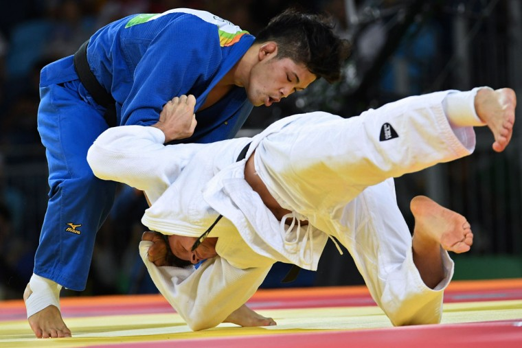 Japan's Shohei Ono (blue) competes with Belgium's Dirk van Tichelt during their men's -73kg judo contest semifinal A match of the Rio 2016 Olympic Games in Rio de Janeiro on August 8, 2016. (TOSHIFUMI KITAMURA/AFP/Getty Images)