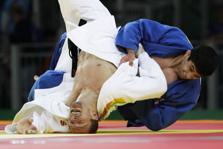 Georgia's Lasha Shavdatuashvili, blue, competes against Russia's Denis Iartcev during the men's 73-kg judo competition at at the 2016 Summer Olympics in Rio de Janeiro, Brazil, Monday, Aug. 8, 2016. (AP Photo/Markus Schreiber)