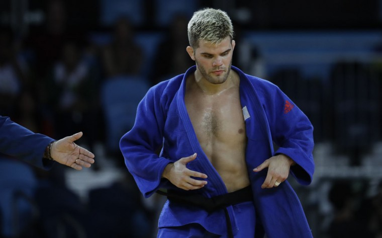 United States' Nicholas Delpopolo looks down while competing against Israel's Sagi Muki during the men's 73-kg judo competition at the 2016 Summer Olympics in Rio de Janeiro, Brazil, Monday, Aug. 8, 2016. (AP Photo/Natacha Pisarenko)