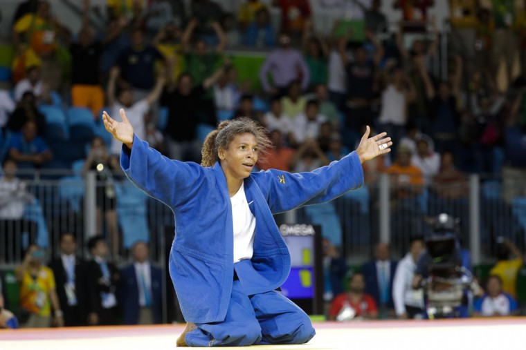 Brazil's Rafaela Silva celebrates after winning the gold medal of the women's 57-kg judo competition at the 2016 Summer Olympics in Rio de Janeiro, Brazil, Monday, Aug. 8, 2016. (AP Photo/Markus Schreiber)