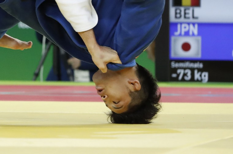 Japan's Shohei Ono (blue) competes with Belgium's Dirk van Tichelt during their men's -73kg judo contest semifinal A match of the Rio 2016 Olympic Games in Rio de Janeiro on August 8, 2016. (JACK GUEZ/AFP/Getty Images)