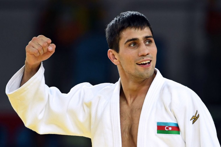 Azerbaijan's Rustam Orujov (white) celebrates after defeating Israel's Sagi Muki during their men's -73kg judo contest semifinal B match of the Rio 2016 Olympic Games in Rio de Janeiro on August 8, 2016. (TOSHIFUMI KITAMURA/AFP/Getty Images)