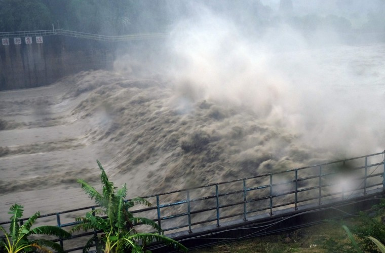 Churning waters in the Jhihtan Dam is seen in Xindian district, New Taipei City, as Typhoon Megi hit eastern Taiwan on September 27, 2016. Taiwan went into shutdown on September 27 as the island faces its third typhoon in two weeks, with thousands evacuated, schools and offices closed across the island and hundreds of flights disrupted. (SAM YEH/AFP/Getty Images)