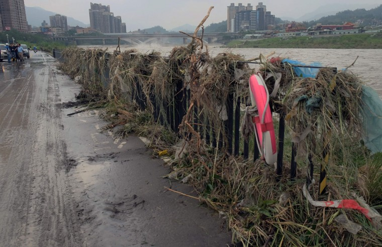 Flood debris covers the banks of the Xindian river in the aftermath of typhoon Megi at Xindian district in New Taipei City on September 28, 2016. Typhoon Megi hit the Chinese mainland early in the morning on September 28 killing one, after leaving a trail of destruction in Taiwan, where four are dead and a million still without power. (SAM YEH/AFP/Getty Images)
