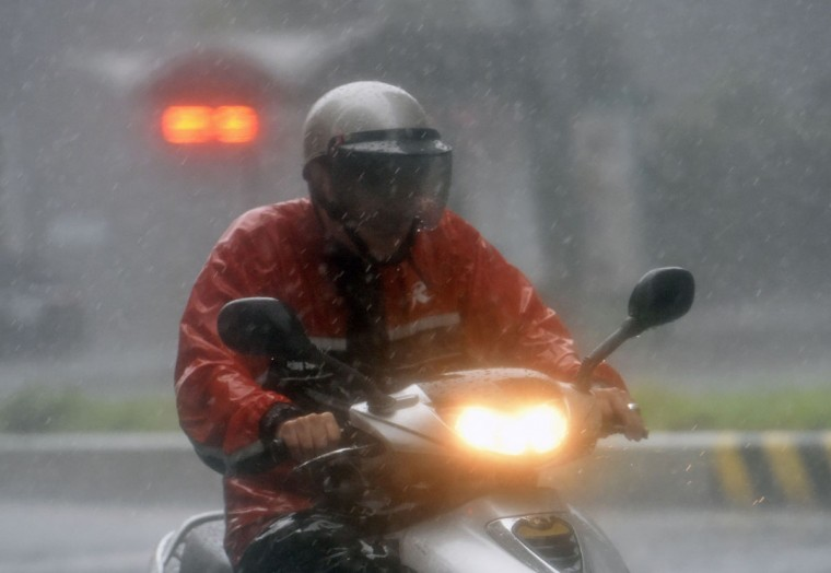 A motorcyclist rides during a storm in Xindian district, New Taipei City, as Typhoon Megi hit eastern Taiwan on September 27, 2016. Taiwan went into shutdown on September 27 as the island faces its third typhoon in two weeks, with thousands evacuated, schools and offices closed across the island and hundreds of flights disrupted. (SAM YEH/AFP/Getty Images)