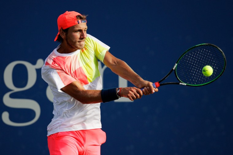 Lucas Pouille of France returns a shot to Roberto Bautista Agut of Spain during his third round Men's Singles match on Day Five of the 2016 US Open at the USTA Billie Jean King National Tennis Center on September 2, 2016 in the Flushing neighborhood of the Queens borough of New York City. (Photo by Andy Lyons/Getty Images)