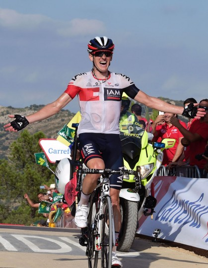 "IAM's Swiss cyclist Mathias Frank celebrates after winning the 17th stage of the 71st edition of ""La Vuelta"" Tour of Spain, a 173.3km route Castellon to Llucena, on September 7, 2016. (Jose Jordan/AFP/Getty Images)"