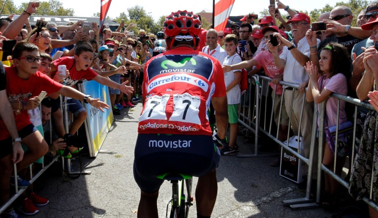 "Movistar's Colombian cyclist Nairo Quintana (C) rides past supporters before the start of the 17th stage of the 71st edition of ""La Vuelta"" Tour of Spain, a 173.3km route Castellon to Llucena, on September 7, 2016. (Jose Jordan/AFP/Getty Images)"