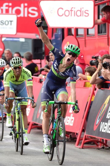 "Orica Bikeexchange's Norwegian cyclist Magnus Cort Nielsen celebrates winning as he crosses the finish line during the 18th stage of the 71st edition of ""La Vuelta"" Tour of Spain, a 191km route Requena to Gandia, on September 8, 2016. (Jose Jordan/AFP/Getty Images)"