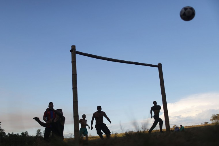 FARC rebels play soccer at the 10th Guerrilla Conference in the remote Yari plains where the peace accord was in the process of being ratified by the FARC on September 22, 2016 in El Diamante, Colombia. The peace agreement, which was ratified tody by the FARC, attempts to end the 52-year-old guerrilla war between the FARC and the state, the longest-running armed conflict in the Americas which left 220,000 dead. The final agreement is set to be signed on September 26 and will then be put to vote by the public in a referendum on October 2. The plan calls for a disarmament and re-integration of most of the estimated 7,000 FARC fighters. (Photo by Mario Tama/Getty Images)