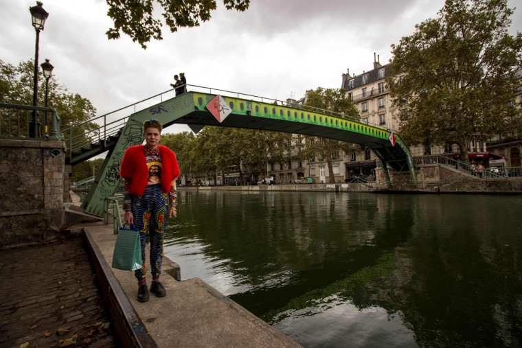 A fashion goer poses at the Canal Saint-Martin during the fashion week in Paris on September 29, 2016. (Martin Bertrand/AFP/Getty Images)