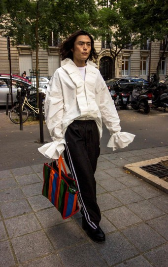 A fashion goer walks on a street during the fashion week in Paris on September 29, 2016. (Martin Bertrand/AFP/Getty Images)
