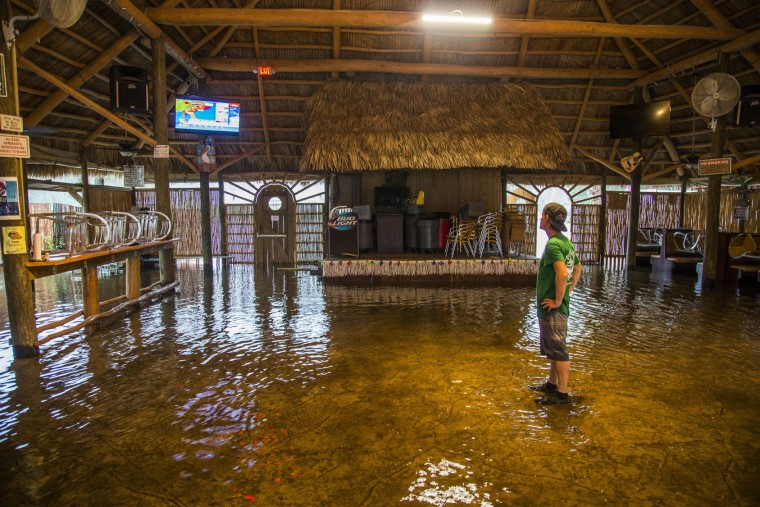 Brian Mugrage watches the weather on TV inside the Riverside Cafe flooded by the storm surge from Hurricane Hermine on September 1, 2016 in Saint Marks, Florida. Hurricane warnings have been issued for parts of Florida's Gulf Coast as Hermine is expected to make landfall as a Category 1 hurricane (Photo by Mark Wallheiser/Getty Images)
