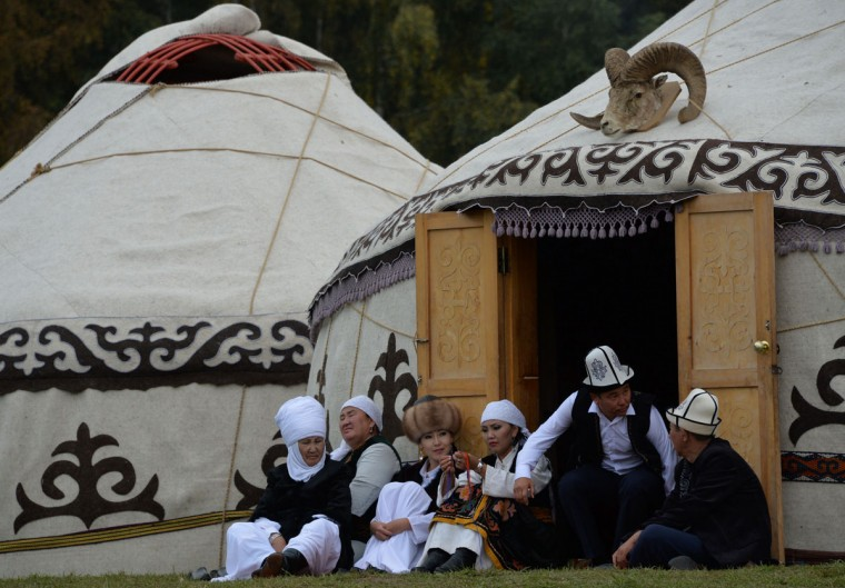 Kyrgyz people rest in front of yurtas (nomad's tents) during the World Nomad Games 2016 in the Kyrchin (Semenovskoe) gorge, some 300 kms outside the capital Bishkek, on September 4, 2016. (VYACHESLAV OSELEDKO/AFP/Getty Images)