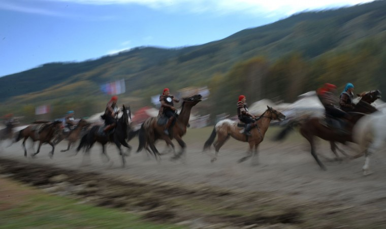 Kyrgyz riders perform during the World Nomad Games 2016 in the Kyrchin (Semenovskoe) gorge, some 300 kms outside the capital Bishkek, on September 4, 2016. (VYACHESLAV OSELEDKO/AFP/Getty Images)