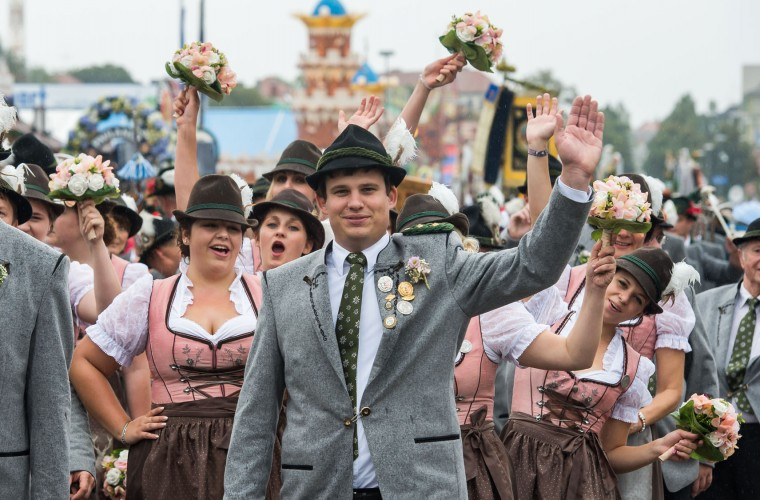 Members of traditional Bavarian costume associations (Trachtenverein), Bavarian bands and riflemen's associations participate in the annual riflemen's parade during day 2 of the 2016 Oktoberfest beer festival at Theresienwiese on September 18, 2016 in Munich, Germany. The 2016 Oktoberfest is taking place under heightened security due to fears over international terrorism. The fest will be open to the public through October 3. (Photo by Joerg Koch/Getty Images)