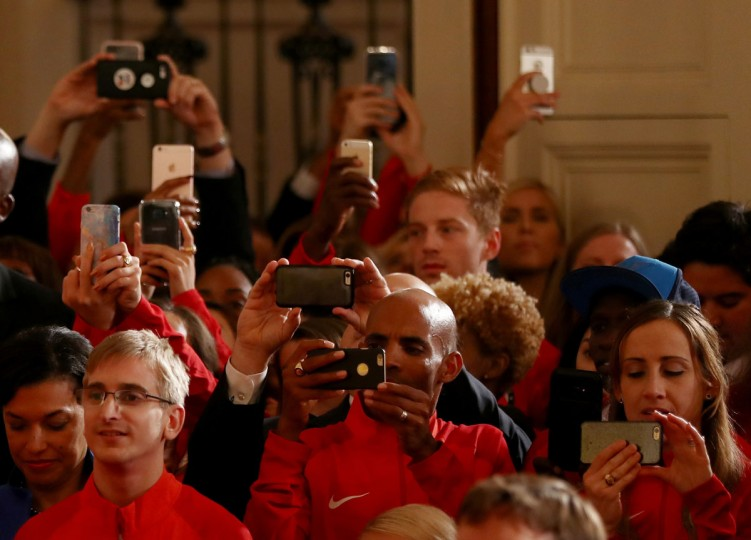 WASHINGTON, DC - SEPTEMBER 29: Members of the U.S. Olympic and Paralympic athletes take pictures of President Obama as he speaks during an East Room event at the White House September 29, 2016 in Washington, DC. President Obama and first lady Michelle Obama welcome the 2016 U.S. Olympic and Paralympic teams to the White House to honor their participation and success in the Rio Olympic Games this year. (Photo by Elsa/Getty Images)
