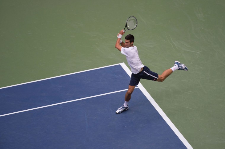 Novak Djokovic of Serbia hits a return to Mikhail Youzhny of Russia during their 2016 US Open men's singles match at the USTA Billie Jean King National Tennis Center on September 2, 2016 in New York. (Don Emmert/AFP/Getty Images)