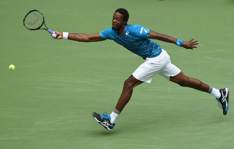 Gael Monfils of France returns the ball against his compatriot Lucas Pouille during their 2016 US Open Men's Singles quarterfinal match at the USTA Billie Jean King National Tennis Center in New York on September 6, 2016. (Timothy A. Clary/AFP/Getty Images)