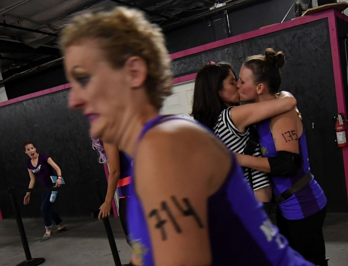 Players prepare as members of the Tough Cookies team competes to compete against the Varsity Brawlers team during the L.A. Derby Dolls women's banked track roller derby event in Los Angeles, California on September 24, 2016. Roller Derby is a contact sport that originated in America and is based on two teams formation roller skating around an oval track, with points scored as one player known as a jammer laps members of the opposing team. The sport, which began in 1922, is played predominantly by women skaters with a strong emphasis on punk aesthetics, unique costumes and humorous stage names. (Mark Ralston/AFP/Getty Images)