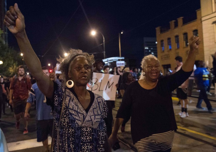 Protesters march during a demonstration against police brutality in Charlotte, North Carolina, on September 21, 2016, following the shooting of Keith Lamont Scott the previous day. A protester in Charlotte, North Carolina was fatally shot by a civilian during a second night of unrest after the police killed a black man, officials said. (Nicholas Kamm/AFP/Getty Images)