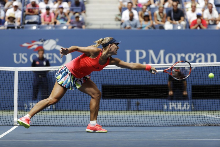 Angelique Kerber, of Germany, can't make a shot against Roberta Vinci, of Italy, during the quarterfinals of the U.S. Open tennis tournament, Tuesday, Sept. 6, 2016, in New York. (AP Photo/Julio Cortez)