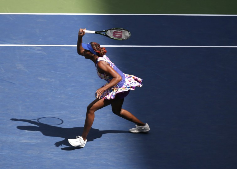 Venus Williams returns a shot to Karolina Pliskova, of the Czech Republic, during the fourth round of the U.S. Open tennis tournament, Monday, Sept. 5, 2016, in New York. (AP Photo/Jason DeCrow)