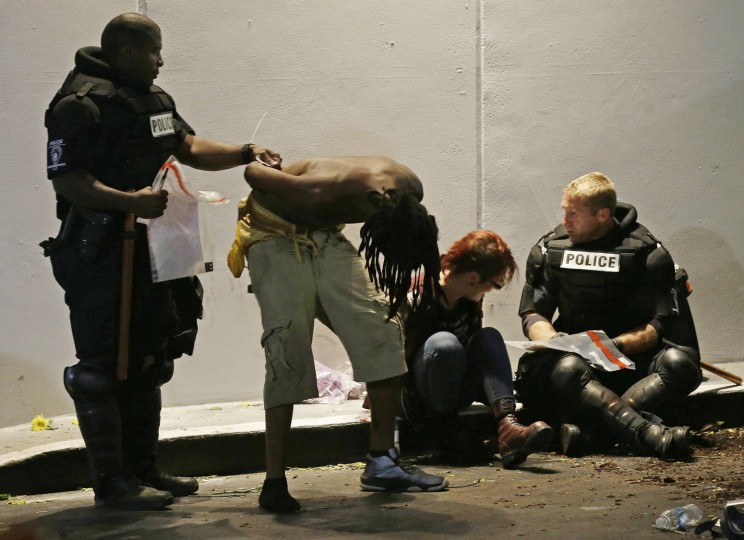 Police detain two people during protests in downtown following Tuesday's police shooting of Keith Lamont Scott in Charlotte, N.C., Wednesday, Sept. 21, 2016. (AP Photo/Gerry Broome)