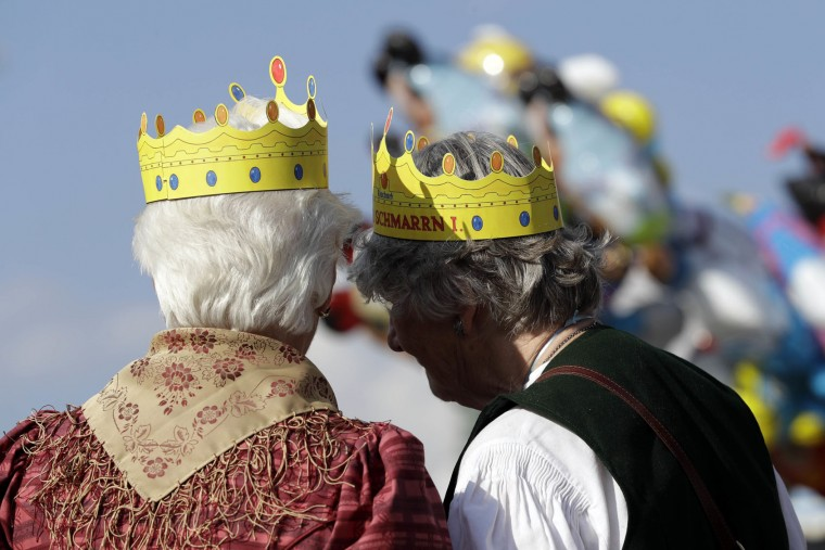 Two elderly ladies wear paper crowns at the 183rd Oktoberfest beer festival in Munich, Germany, Monday, Sept. 26, 2016. The world's largest beer festival will be held from Sept. 17 to Oct. 3, 2016. (AP Photo/Matthias Schrader)