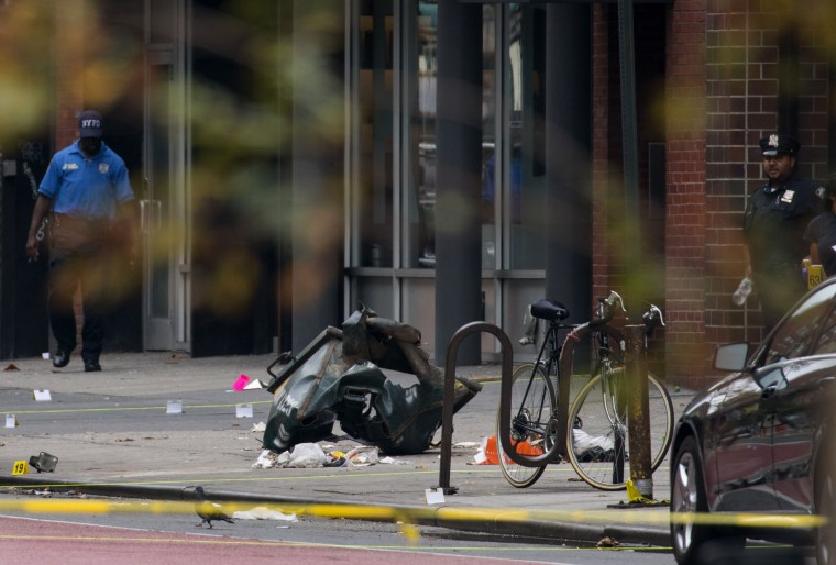 Debris and a mangled toolbox sit on the sidewalk at the scene of an explosion on West 23rd street in the Chelsea neighborhood of New York, Sunday, Sept. 18, 2016, after an incident that injured passers-by Saturday evening. (AP Photo/Craig Ruttle)
