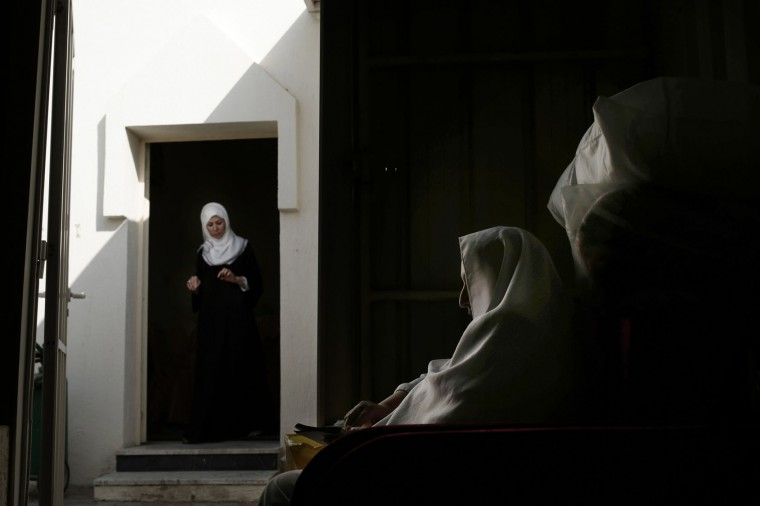 In this Sunday, Sept. 11, 2016 photo, an Egyptian woman prays inside the women's camp in Arafat during the annual hajj pilgrimage, near the holy city of Mecca, Saudi Arabia. The pilgrimage, required of able-bodied Muslims once in their life, brings the Islamic world together across its many languages, ethnicities and individual beliefs. That's something seen across the many faces of its female faithful. Many who took part in this year's pilgrimage described finding peace and fulfillment by taking part in it. (AP Photo/Nariman El-Mofty)