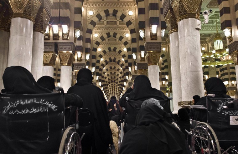 In this Thursday, Sept. 15, 2016 photo, a Saudi woman teaches Islam to women in Al-Masjid an-Nabawi or Prophet Muhammad's Mosque, which situates Muhammad's tomb, in Medina, Saudi Arabia. (AP Photo/Nariman El-Mofty)