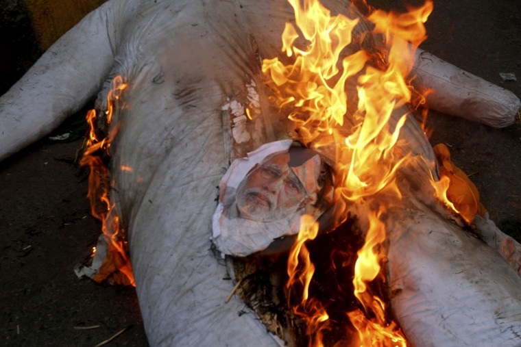 Pakistani protesters burn an effigy of Indian Prime Minister Narendra Modi in Karachi, Pakistan, to condemn the killings of Pakistani soldiers, Friday, Sept. 30, 2016. Tension along the India-Pakistan border has grown sharply since a deadly Sept. 18 attack on an Indian military base in Kashmir. New Delhi blamed the attack on militants belonging to the outlawed group Jaish-e-Mohammed, which has its headquarters in Pakistan. Islamabad denies that. (AP Photo/Fareed Khan)