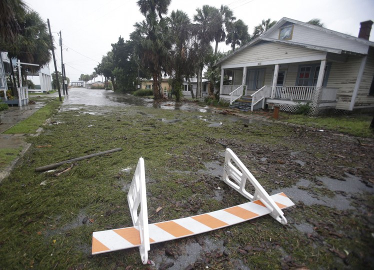 Seaweed covers a flooded street in Cedar Key, Fla. as Hurricane Hermine nears the Florida coast, Thursday, Sept. 1, 2016. Hurricane Hermine gained new strength Thursday evening and roared ever closer to Florida's Gulf Coast, where rough surf began smashing against docks and boathouses and people braced for the first direct hit on the state from a hurricane in over a decade. (AP Photo/John Raoux)