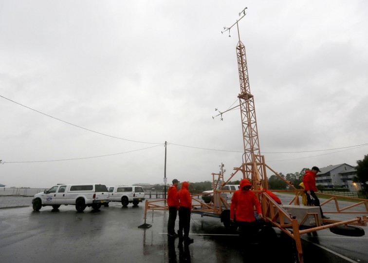 A team of University of Florida hurricane researchers work to take down wind-monitoring equipment as Hurricane Hermine approaches on Thursday, Sept. 1, 2016, in Steinhatchee, Fla. The team moved the equipment farther inland to keep it safe from the surge. Hurricane Hermine gained new strength Thursday evening and roared ever closer to Florida's Gulf Coast, where rough surf began smashing against docks and boathouses and people braced for the first direct hit on the state from a hurricane in over a decade. (Matt Stamey/The Gainesville Sun via AP)