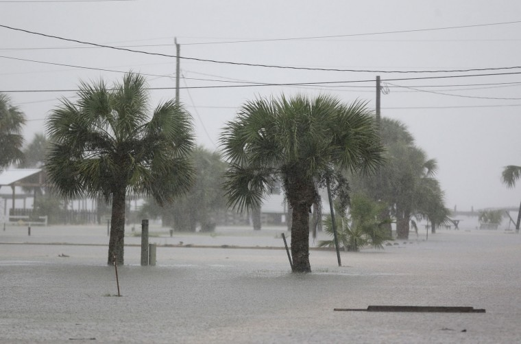 Ground water begins to flood some low areas as Tropical Storm Hermine heads inland Thursday, Sept. 1, 2016, in Dekle Beach, Fla. A hurricane warning was in effect for Florida's Big Bend from the Suwannee River to Mexico Beach. (AP Photo/John Raoux)