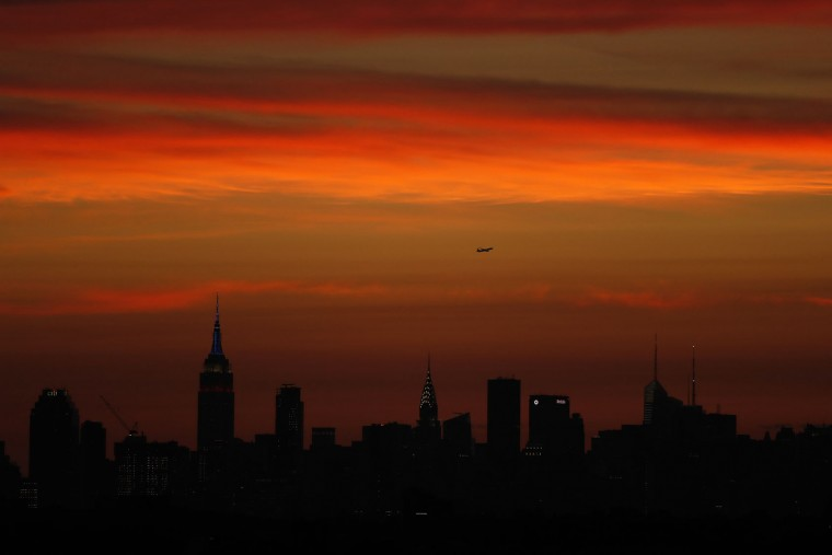 The New York skyline is seen from the U.S. Open tennis tournament after sunset, Monday, Sept. 5, 2016, in New York. (AP Photo/Adam Hunger)