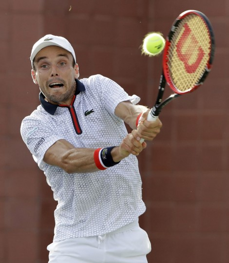 Roberto Bautista Agut, of Spain, can't make the shot to Lucas Pouille, of France, during the third round of the U.S. Open tennis tournament, Friday, Sept. 2, 2016, in New York. (AP Photo/Darron Cummings)