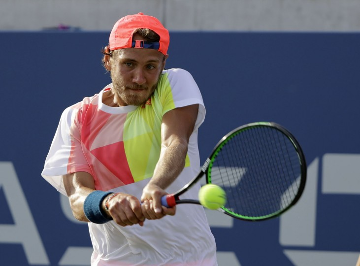 Lucas Pouille, of France, returns a shot to Roberto Bautista Agut, of Spain, during the third round of the U.S. Open tennis tournament, Friday, Sept. 2, 2016, in New York. (AP Photo/Darron Cummings)