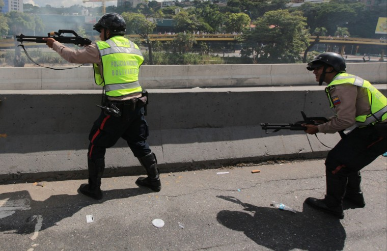 "Bolivarian National Police officers fire rubber bullets at demonstrators during an anti-government protest in Caracas, Venezuela, Thursday, Sept 1, 2016. Venezuela's opposition is vowing to keep up pressure on President Nicolas Maduro after flooding the streets of Caracas with demonstrators Thursday in its biggest show of force in years. Protesters filled dozens of city blocks in what was dubbed the ""taking of Caracas"" to pressure electoral authorities to allow a recall referendum against Maduro this year.(AP Photo/Fernando Llano)"