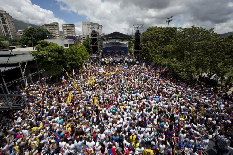 "Demonstrators take part in the ""taking of Caracas"" march in Caracas, Venezuela, Thursday, Sept. 1, 2016. Venezuela's opposition is vowing to keep up pressure on President Nicolas Maduro after flooding the streets of Caracas with demonstrators Thursday in its biggest show of force in years. Protesters filled dozens of city blocks in what was dubbed the ""taking of Caracas"" to pressure electoral authorities to allow a recall referendum against Maduro this year. (AP Photo/Ariana Cubillos)"