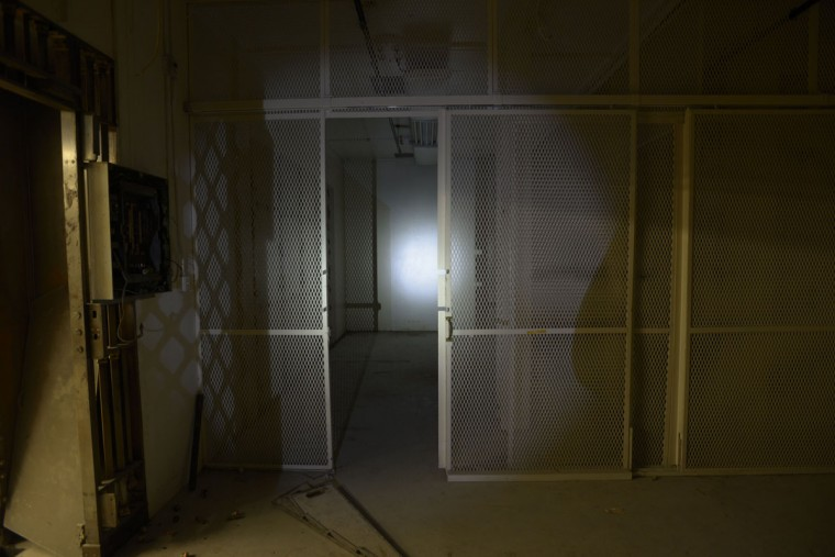 A holding area for prisoners inside the basement of the old Federal Reserve bank in Baltimore, today the Lenore apartments. (Christina Tkacik/Baltimore Sun)