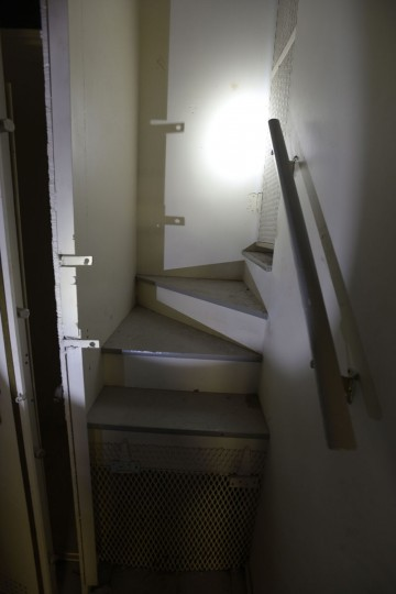 A narrow stairway connects the two vaults in the basement of the Federal Reserve bank in Baltimore, which today is the Lenore apartments. (Christina Tkacik/Baltimore Sun)