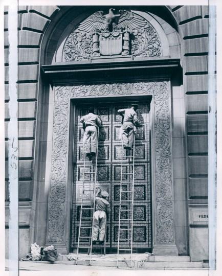 Workmen polishing the Federal Reserve Bank doors in 1963. (Malashuk/Baltimore Sun)