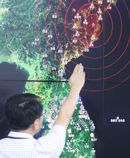 An official points to North Korea's northeastern county of Kilju, where the communist country conducted a nuclear test, on Sept. 9, 2016 at the Korea Meteorological Agency in Seoul. The test, the fifth of its kind following its first in 2006, second in 2009, third in 2013 and fourth in January 2016, caused a 5 magnitude tremor. North Korean news media, including the Korean Central TV Station, confirmed the latest nuclear test in their reports later in the day. (Yonhap News/Newscom/Zuma Press/TNS)